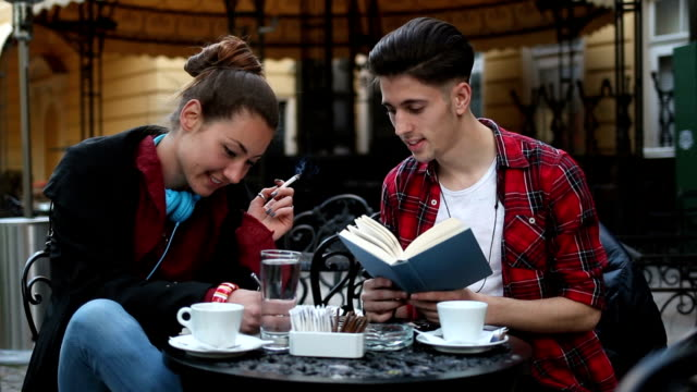 Students studying in cafe, smoking and smiling video