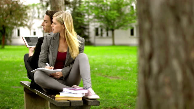LS Students Studying On The Bench In The Park video
