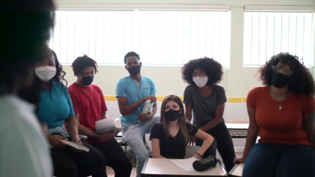 Students wearing face mask during an informal class video