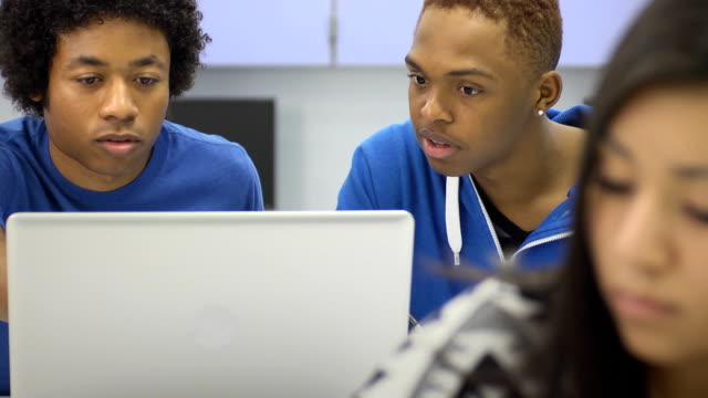 Students with Laptop Computer in Classroom video