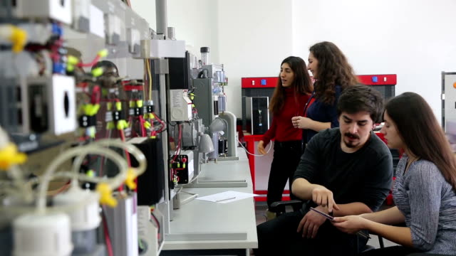 students working in laboratory of renewable energy. - energia rinnovabile video stock e b–roll