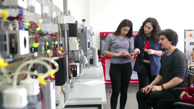 Students working in laboratory of renewable energy. video