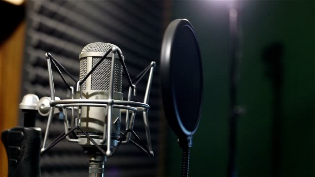 Studio recording, professional microphone in the recording studio, close up video