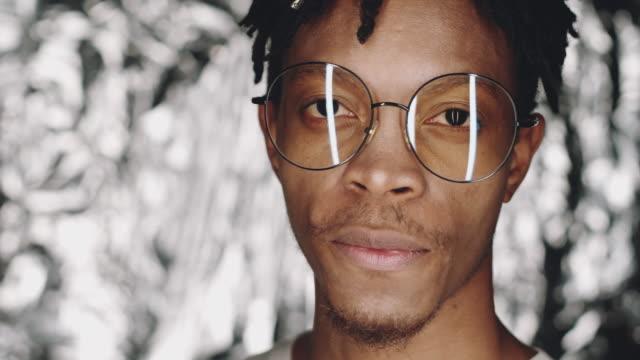 Studio Shot of Cheerful Black Man in Glasses Smiling at Camera