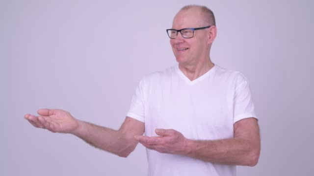 studio shot of handsome senior man - one mature man only stock videos & royalty-free footage