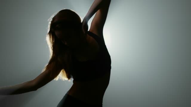 studio shot of sensual woman dancing - scarpe video stock e b–roll
