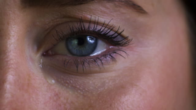 Studio Shot Of Unhappy Young Woman Crying Eyes Studio Shot Of Unhappy Young Woman Crying Eyes torn stock videos & royalty-free footage