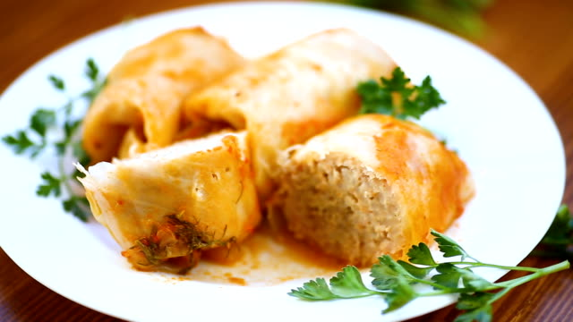 Stuffed cabbage leaves with minced meat and rice in tomato sauce. video