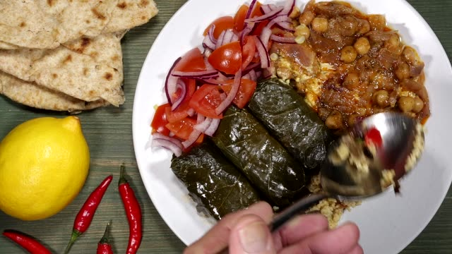 Stuffed Vine Leaves With Couscous And Hummus And Salad Vegetarian Style Stuffed Vine Leaves With Couscous Hummus And Salad stuffed stock videos & royalty-free footage