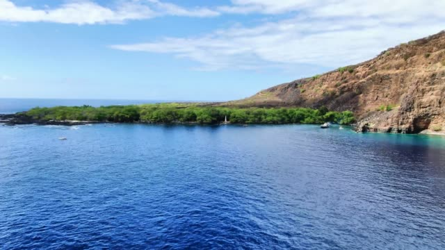 Stunning aerial drone footage of the Captain James Cook monument in Kealakekua Bay, Big Island, Hawaii.The monument marks the spot where James Cook was killed in a fight with native Hawaiians in 1779. Stunning aerial drone footage of the Captain James Cook monument in Kealakekua Bay, Big Island, Hawaii.The monument marks the spot where James Cook was killed in a fight with native Hawaiians in 1779. big island hawaii islands stock videos & royalty-free footage