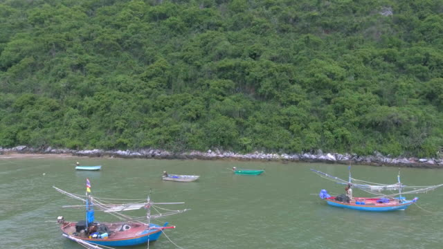 Stunning aerial shot islands in Thailand with boats in foreground video