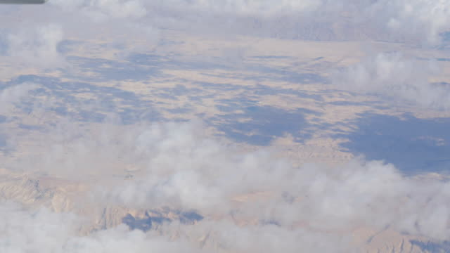 Stunning beauty floats over desert mountain landscape. Top view from an airplane. video