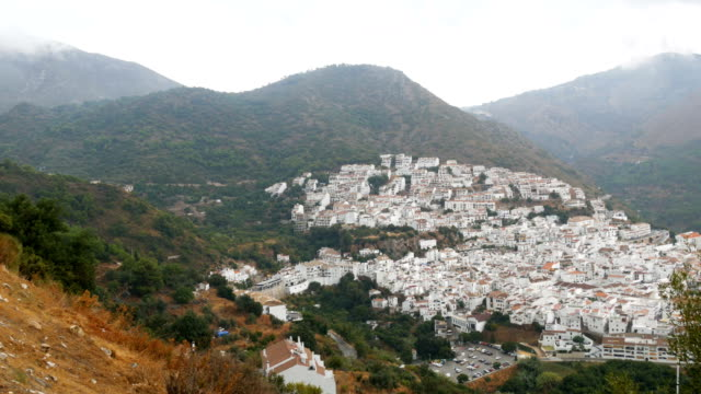 Stunning beauty of the white villages of Andalusia in Spain. Many white houses are high in the mountains,panoramic view video