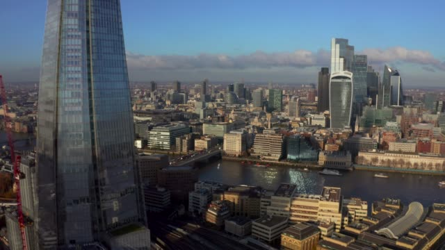 Stunning panorama view over Thames river, the Shard Stunning panorama view over Thames river, the Shard, the London skyline and cityscape from the skyscraper. Aerial photo over the big city. london architecture stock videos & royalty-free footage