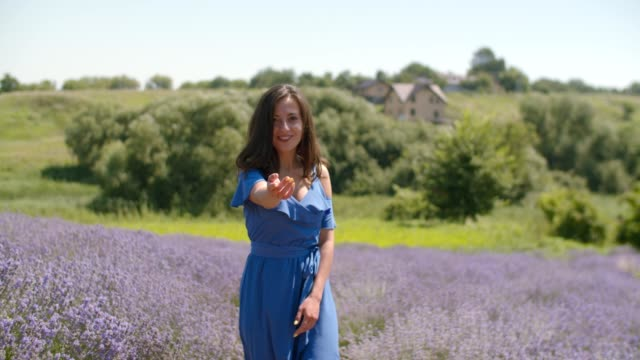 stunning smiling woman beckoning in lavender field - temptation stock videos & royalty-free footage