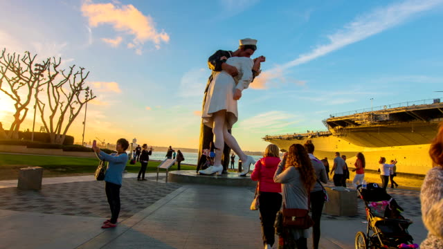 a stunning time-lapse at the kissing statue in sunny san diego, california. - travel agent stock videos and b-roll footage