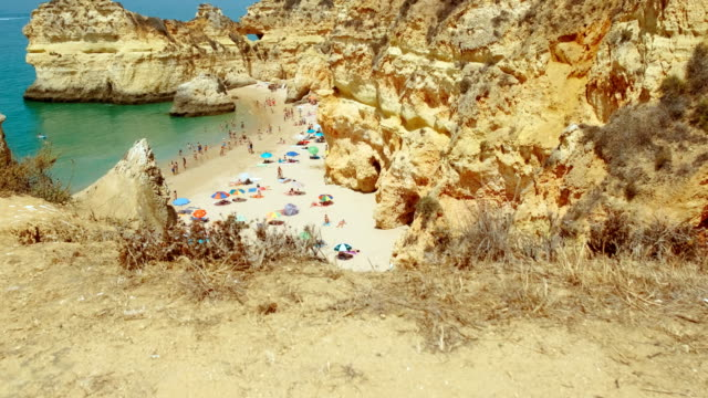 Stunning View of Tres Irmaos Beach, Alvor, The Algarve, Portugal Breathtaking wide view of pristine waters and beautiful rock formations in Tres Irmaos Beach in Alvor, The Algarve, Portugal portugal stock videos & royalty-free footage