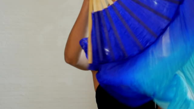 A stunningly beautiful African American model with flowing blue fabric video
