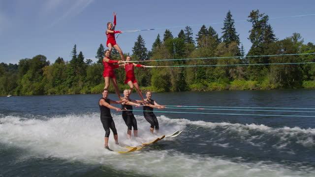 stunt water skiers form human pyramid - pyramidform bildbanksvideor och videomaterial från bakom kulisserna