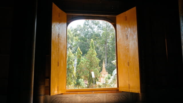 Stupa in the garden through the door temple and zoom in outside video