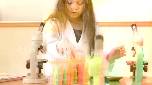 CSI style montage of young scientist with overlay.mov video