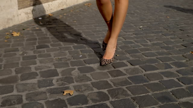 Stylish beautiful sexy woman's legs walking in the city-slow motion Stylish beautiful sexy woman's legs walking in the city-slow motion dress shoe stock videos & royalty-free footage