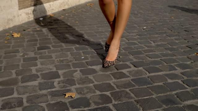 stylish beautiful sexy woman's legs walking in the city-slow motion - scarpe video stock e b–roll