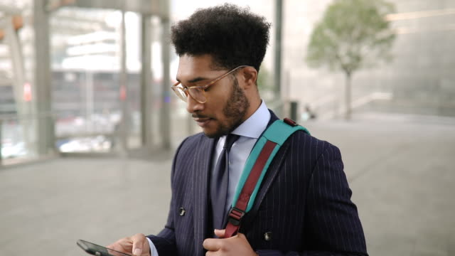 Stylish Business man using smart phone on his way home