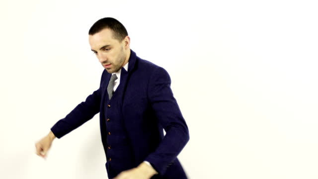 A stylish businessman in a suit prepares to work. video