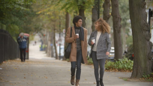 Stylish Couple Walk On Fall Street In City In Slow Motion video