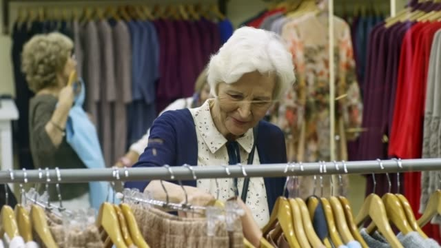 Stylish Elderly Women in Clothes Store video