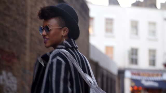 Stylish Fashion Blogger Walking Along Urban Street