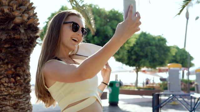 Stylish Girl Using Mobile Phone And Taking Selfie On A