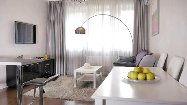 stylish living room in a new apartment - high rise buildings stock videos & royalty-free footage