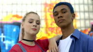 istock Stylish male and female teenagers looking camera, urban youth trends, subculture 1174528430
