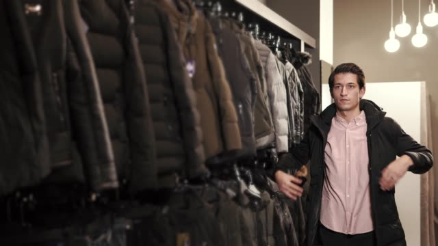 Stylish man trying on a jacket video