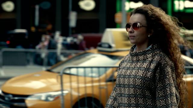 Stylish woman in sunglasses walking along New York street video