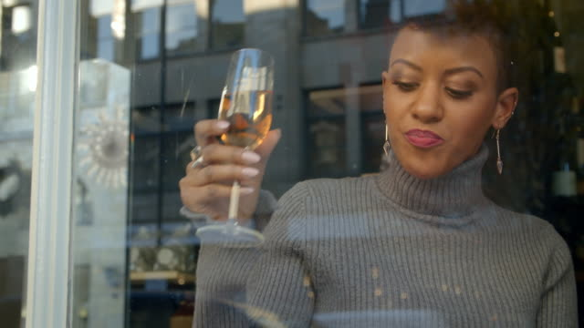 Stylish Woman Sitting In Window Of Bar Using Mobile Phone video