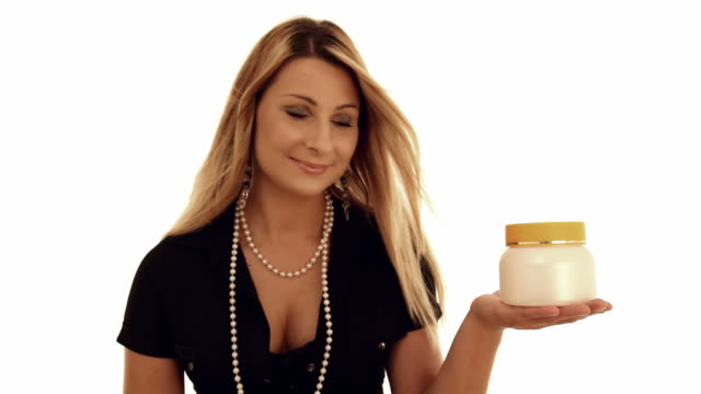 Stylish young woman advertises cream video
