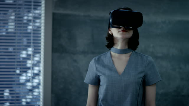 Stylish Young Woman Uses Virtual Reality Headset. She's chief IT Engineer for a New Promising Software Company. video