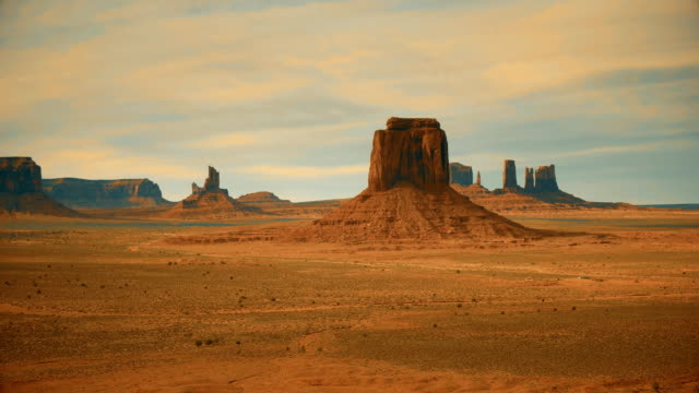 stylized zoom in shot of merrick butte in monument valley
