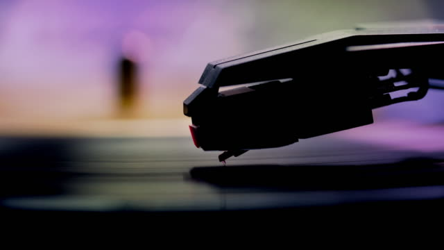 Stylus and record turntable. Close up.