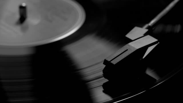 Stylus and record turntable. Monochrome.