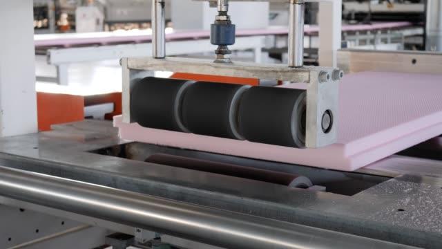styrofoam on grinding machine-tool, automatic equipment for production foam polystyrene at factory - poliuretano polimero video stock e b–roll