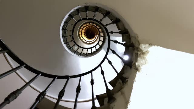 subjective view while climbing an ancient spiral staircase with iron handrail subjective view while climbing an ancient spiral staircase with iron handrail concrete architecture stock videos & royalty-free footage