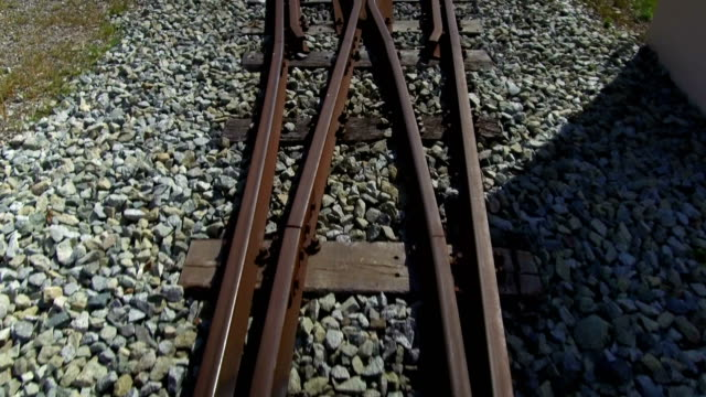 Subjective vision in motion over old train tracks. Narrow track, with old railroad switch and bifurcation of tracks. railroad track stock videos & royalty-free footage