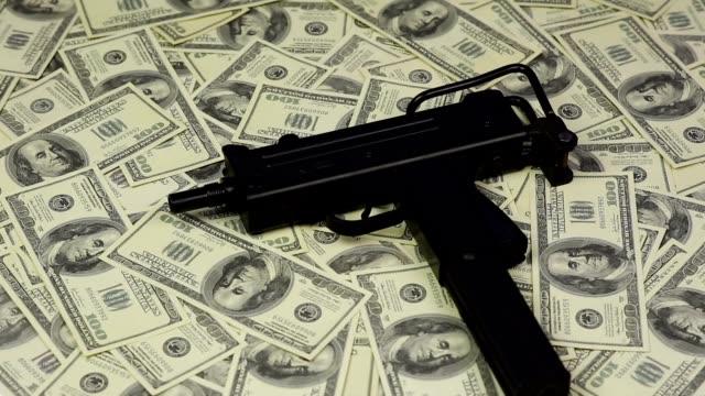 Submachine gun on dollars background video