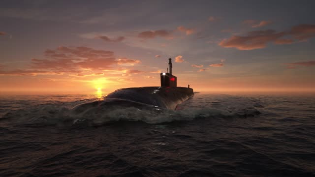 Submarine floating in ocean Submarine floating in ocean at sunset nuclear missile stock videos & royalty-free footage