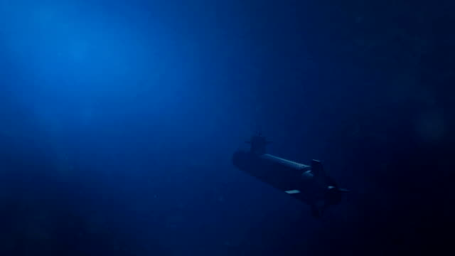 submarine swims away from the camera in the ocean - joseph kelly stock videos and b-roll footage