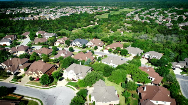 Suburb Real estate Hill country homes Aerial drone views orbiting around Suburb neighborhood outside of Austin , in Cedar Park , Texas , USA , the Hill Country of Central Texas Real Estate Property victorian architecture stock videos & royalty-free footage
